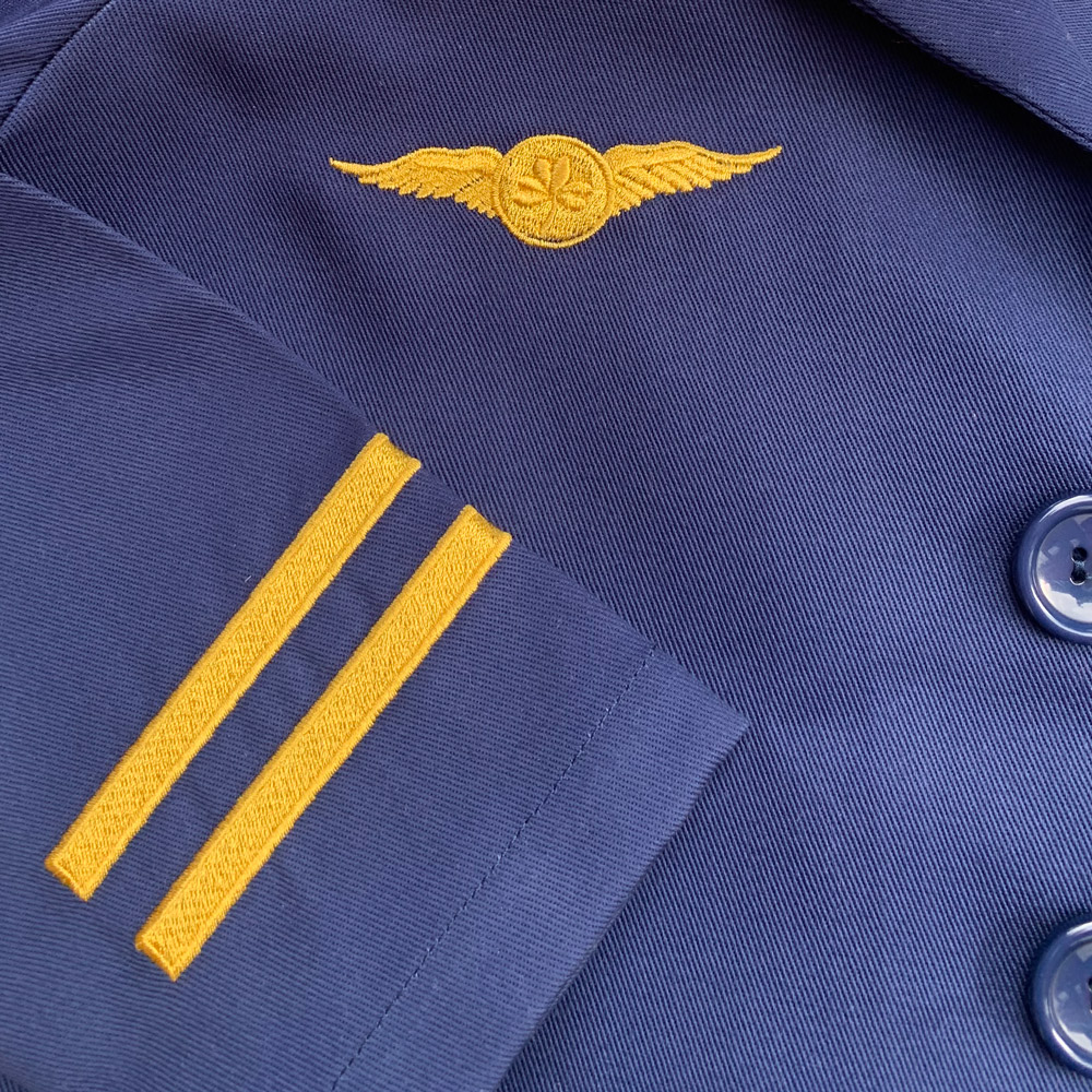 Gold embroidery detail on chest and cuff of childrens pilot uniform