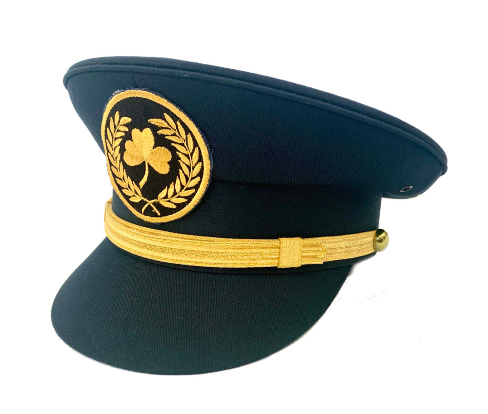 Front view of a childrens navy pilot cap with gold band and embroidered shamrock emblem