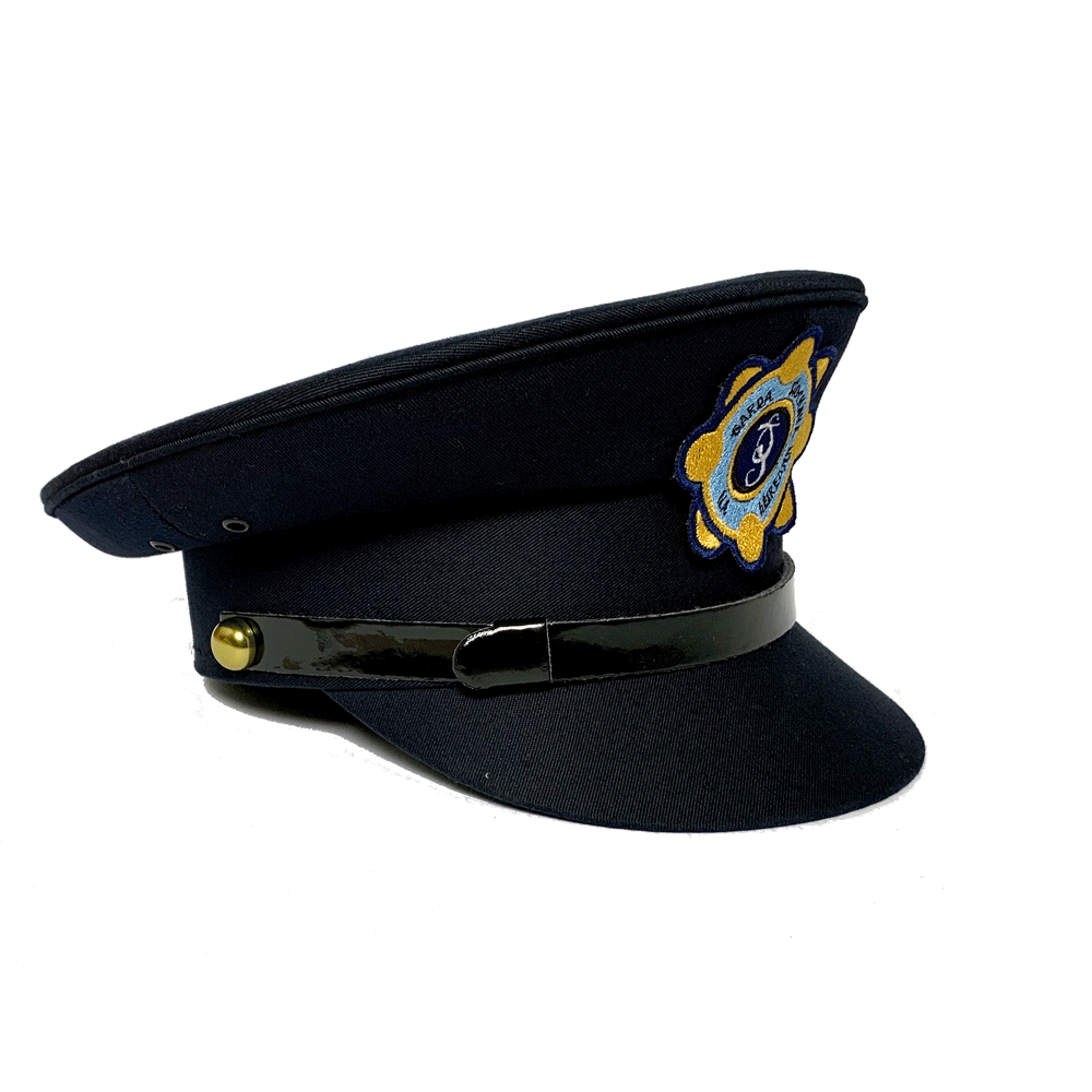 Side view of a childrens Garda Siochana cap with embroidered emblem